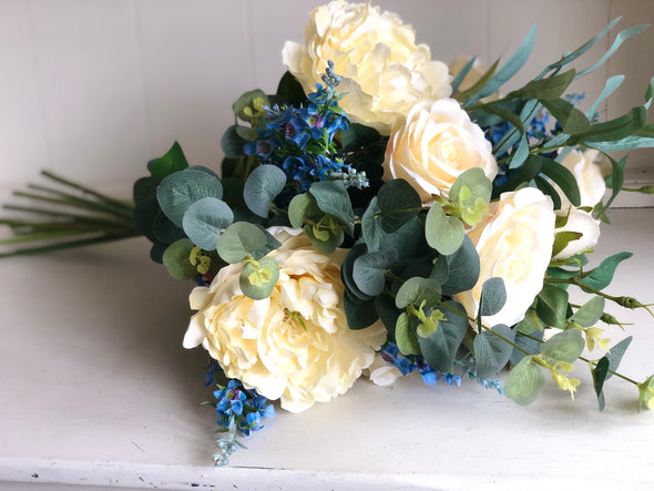 Buttercream peonies, roses and blue catmint silk flower tied arrangement.