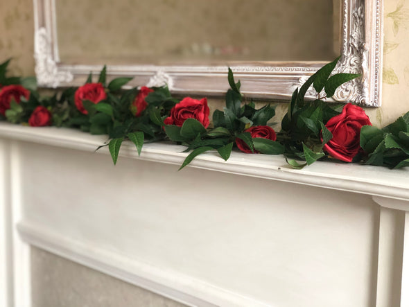 Red roses and ruscus faux flowers garland.