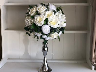 White and green silk flower arrangement.