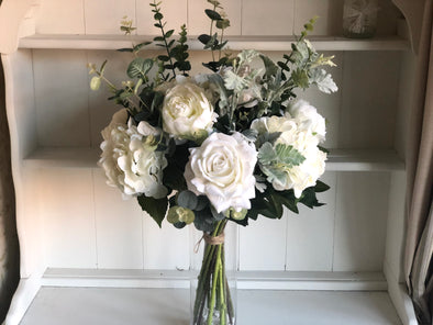 White roses, hydrangea and peonies silk flower tied arrangement.