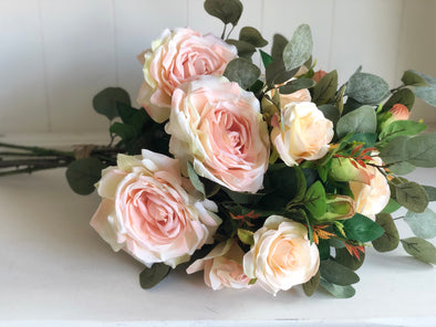 Blush pink roses and eucalyptus silk flower arrangement