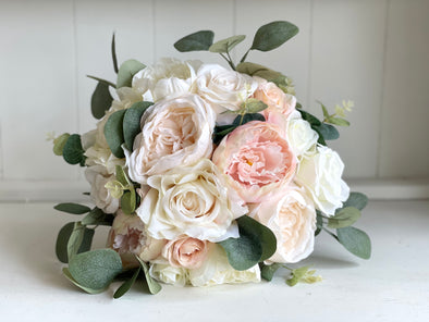 Romantic, blush, ivory and nude silk wedding bouquet.