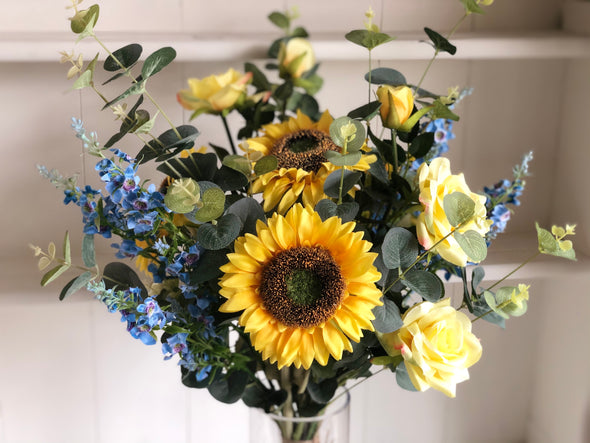 Sunflowers, roses and blue catmint silk flower tied arrangement.