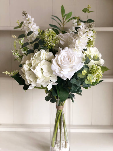Natural white and green silk flower tied arrangement.