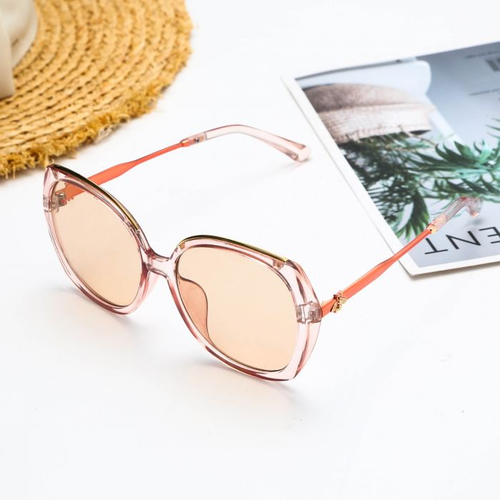 pale pink oversized sunglasses with bee detail