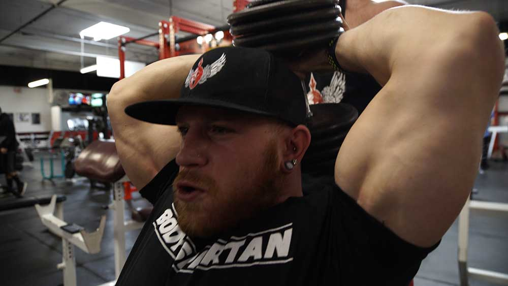 Triceps overhead dumbbell extensions