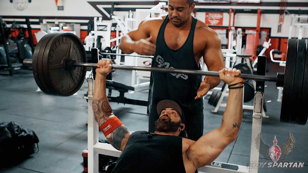 Chest workout using incline barbell press, starting position