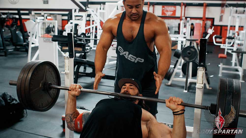 Chest workout using incline barbell press, lowered