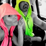 Priscilla and Gabe in pink and green hoodies