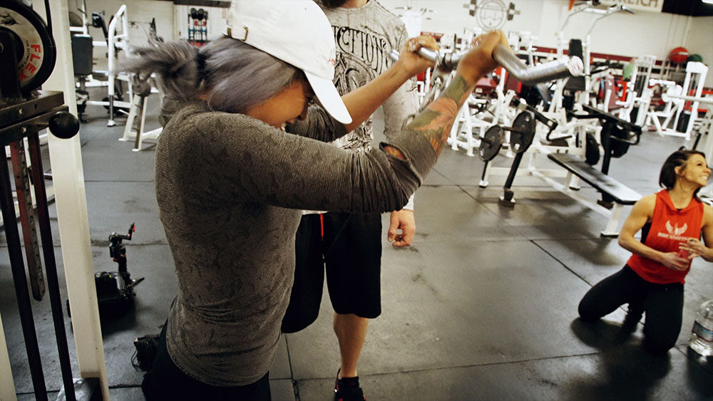 cable front raises, shoulder workout for girls