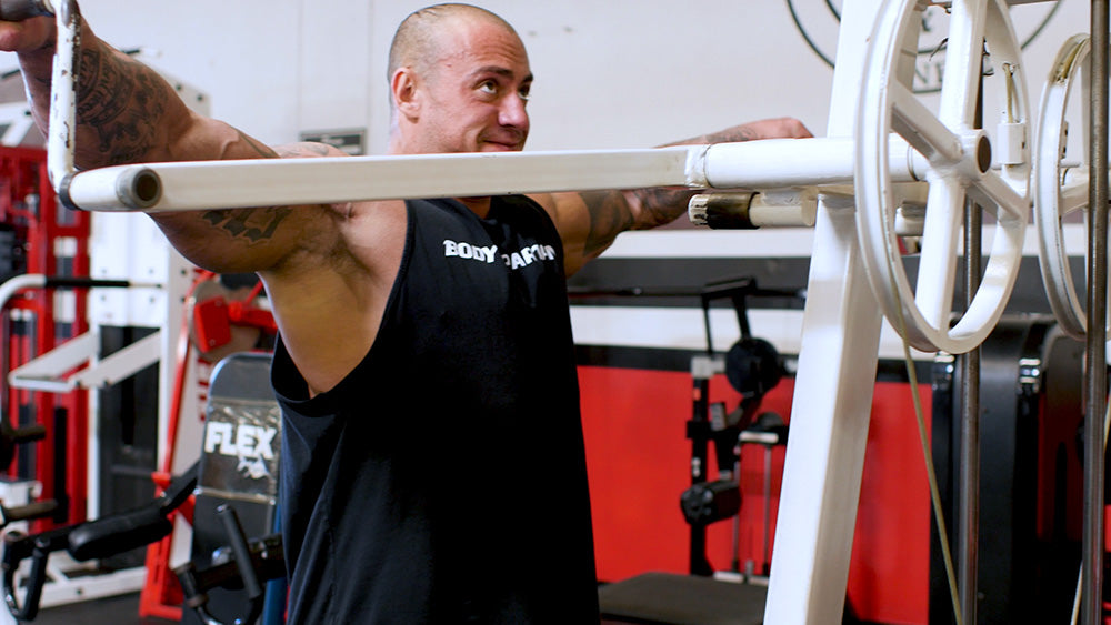 Machine side lateral raises for shoulders