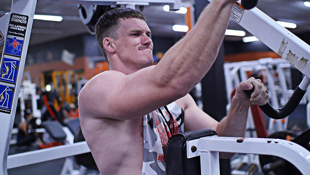 Time under tension lat pulldowns on a Hammer Strength machine