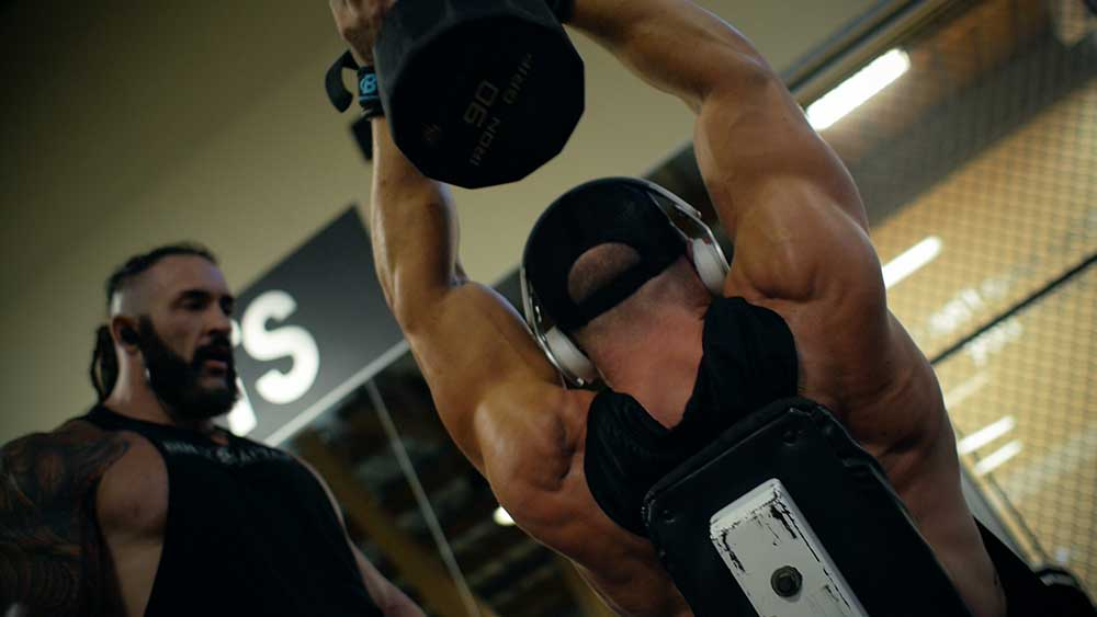 Back and triceps workout with overhead extensions