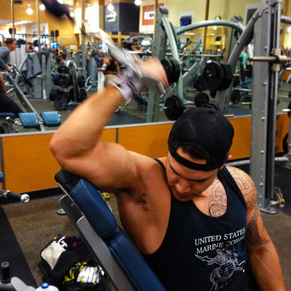 Bicep curls on an incline bench used in the arm workout