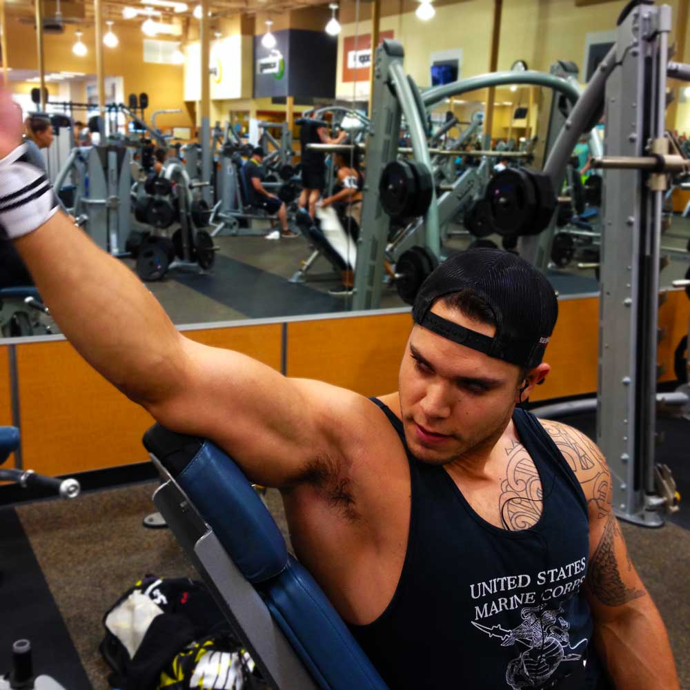 Bicep curls on an incline bench for your arm workout