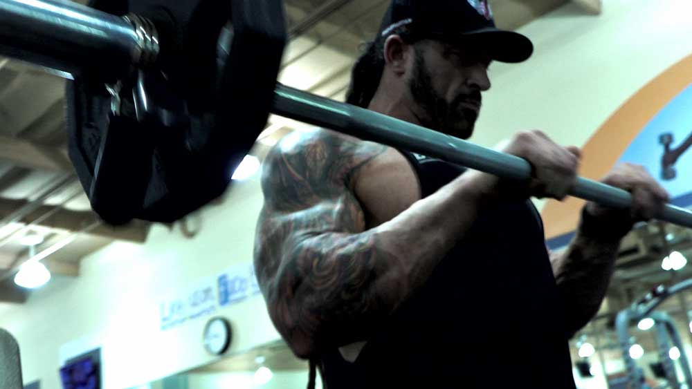 Reverse curls with barbell for forearm workouts