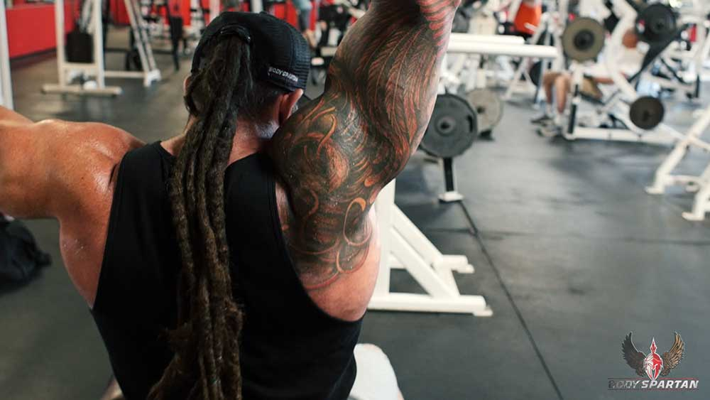 single arm pulldowns position 2 for back workout