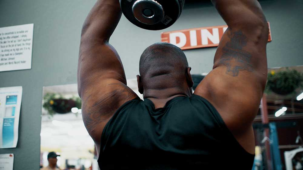 Standing triceps overhead extensions position 2