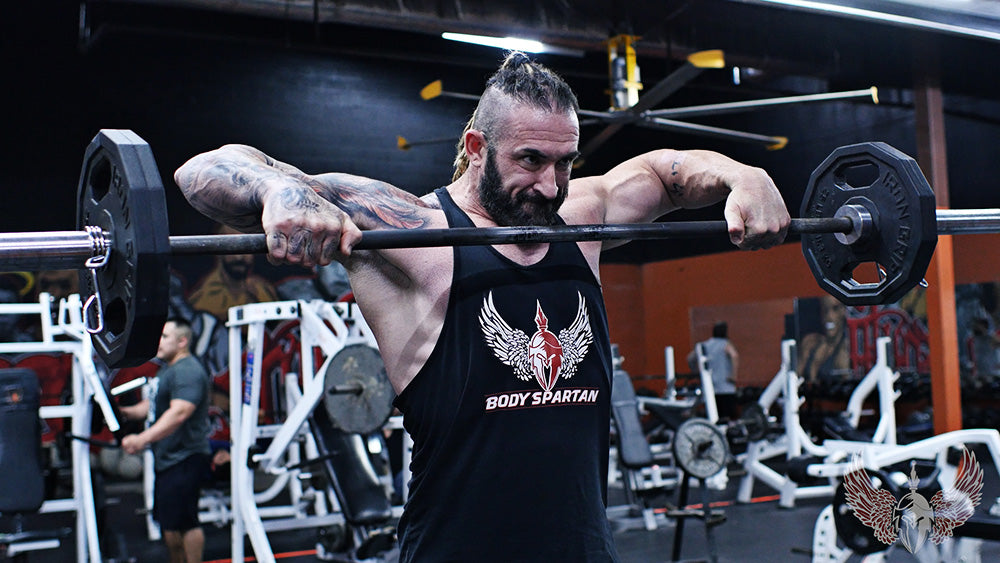 Wide grip upright row for shoulder workout