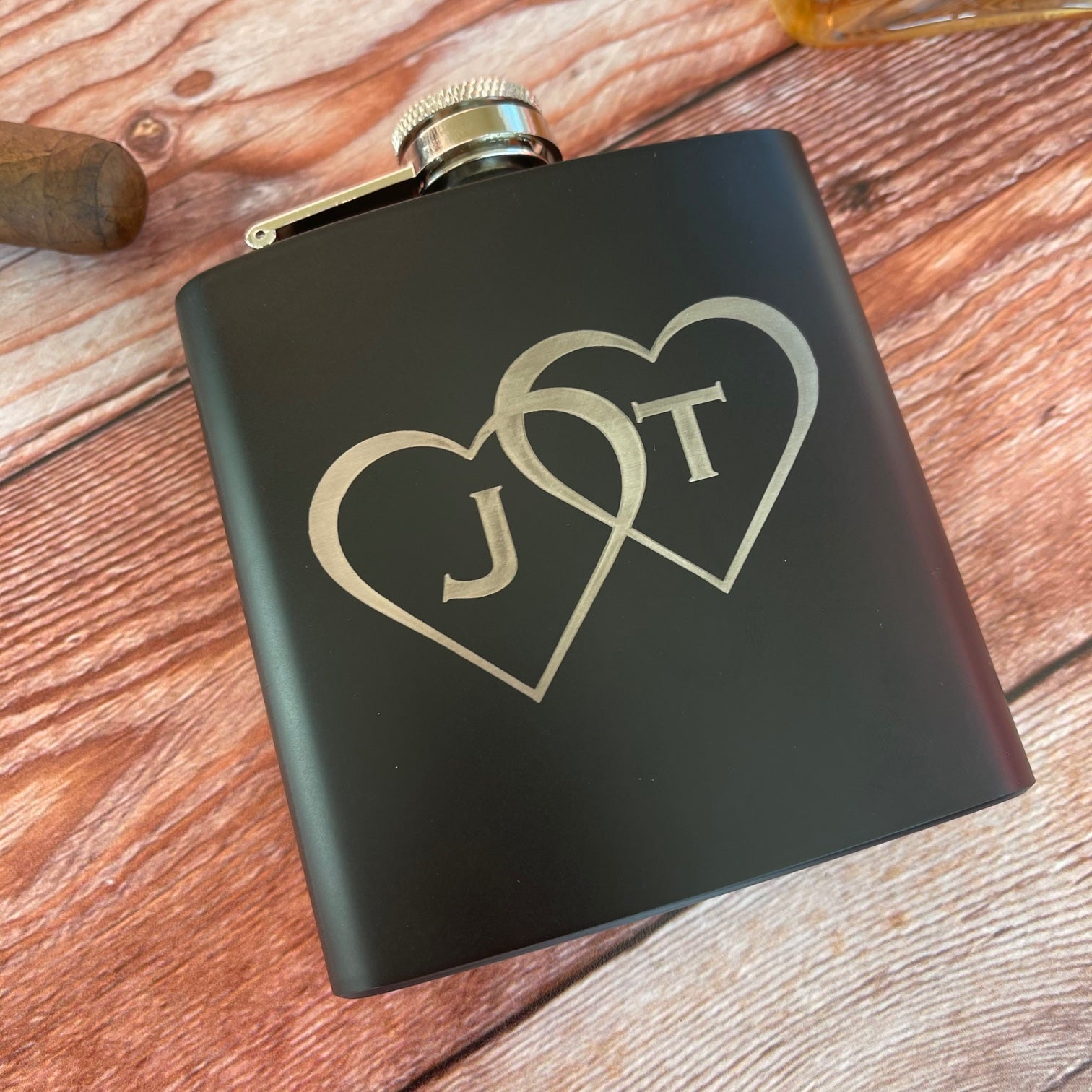 black flask with hearts and initials
