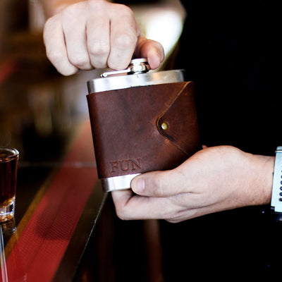 Metal Flask With Engraved Brown Leather Wrapping