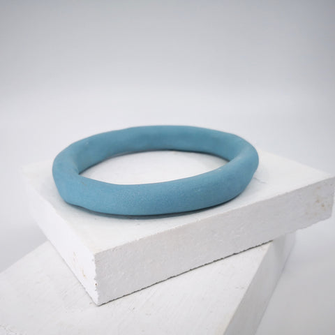 Porcelain bangle in blue by Angela Francis