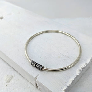 Silver Bangle with Feather-print Slider by Buster Collins