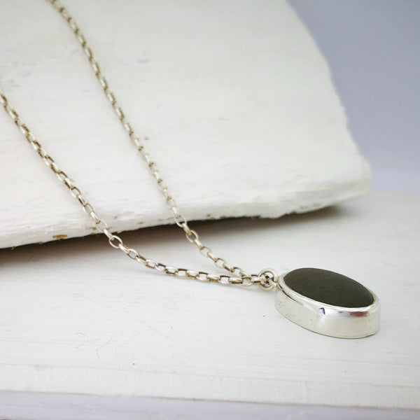 Seatoun Pebble Pendant by Claire McSweeney.  Oval greywacke stone found at Seatoun, set in fine silver.