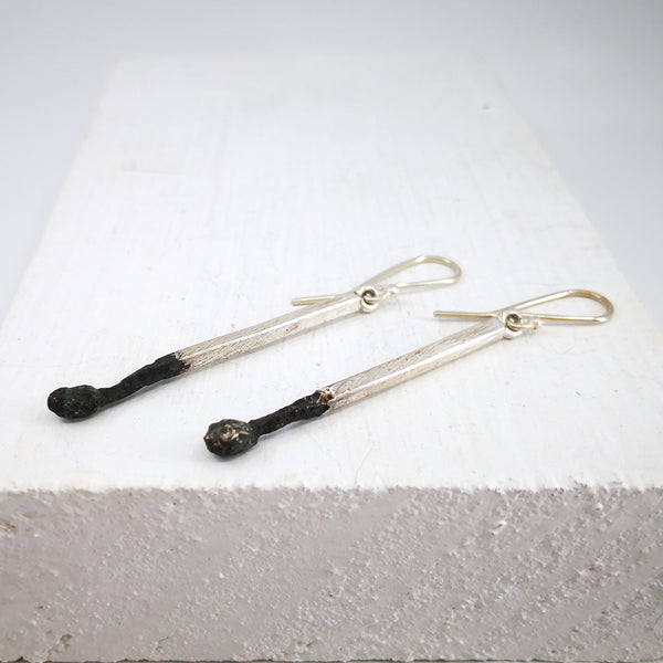 The Burnt Match Stick Earrings in solid silver by David McLeod.
