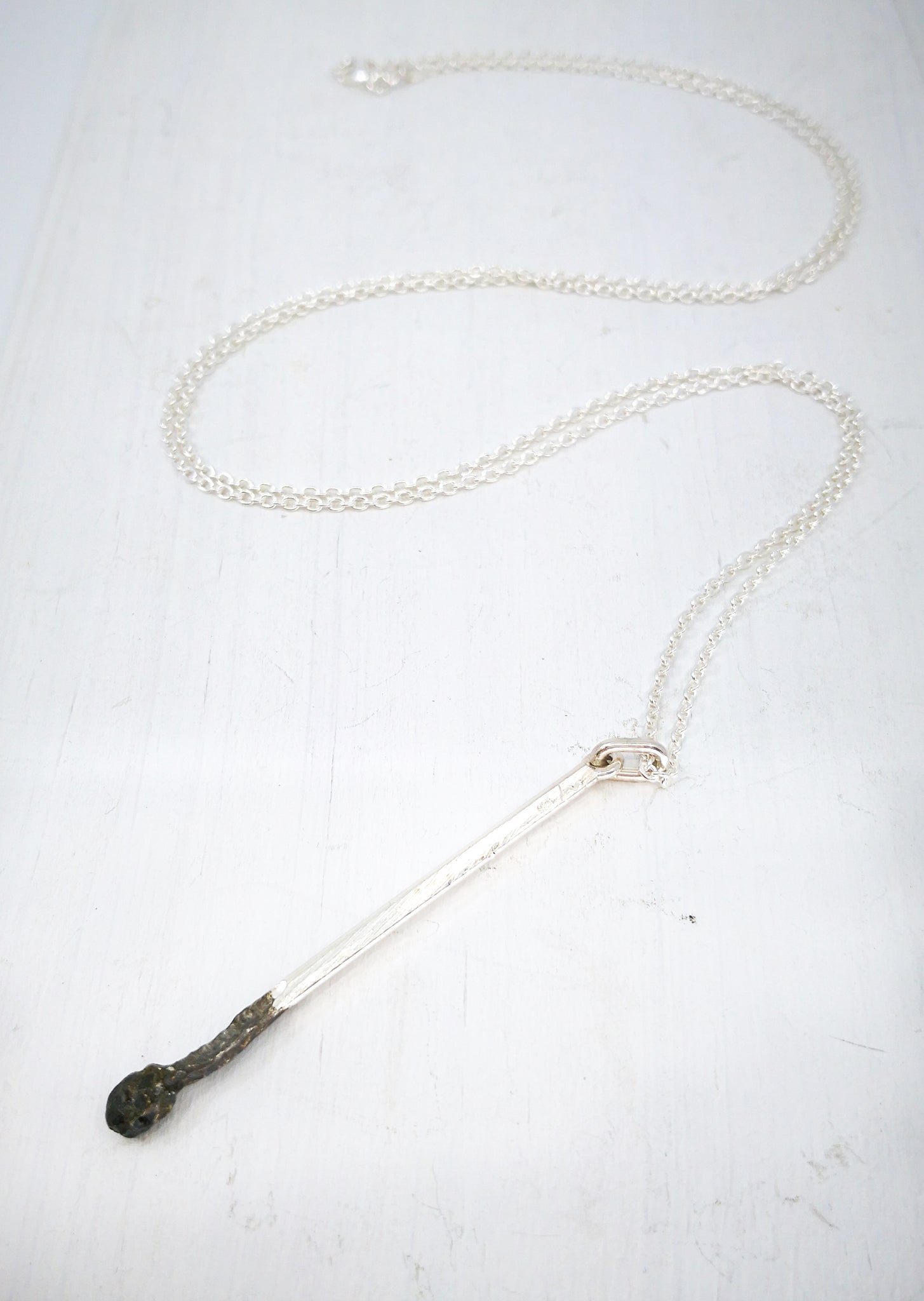 Burnt Match Pendant in silver by David McLeod