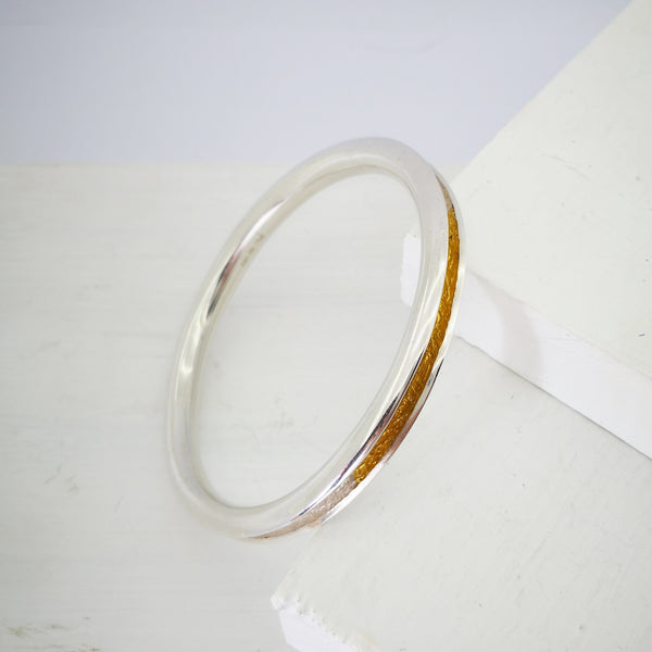 TEXT-ure Bangle in Silver and 22ct gold by David McLeod