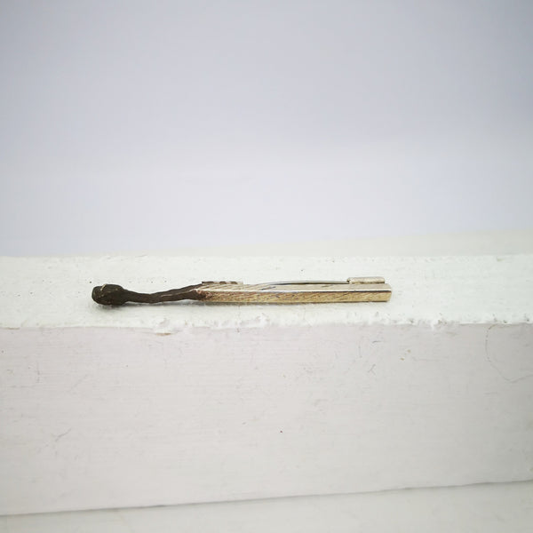 The Burnt Match Stick brooch by David McLeod. Hand made in sterling silver.