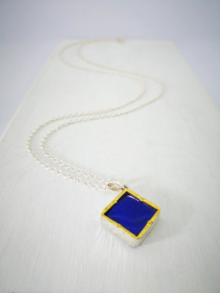 Square Lapis Pendant by David McLeod.  Set in Silver and 22ct gold and hung on a silver chain.