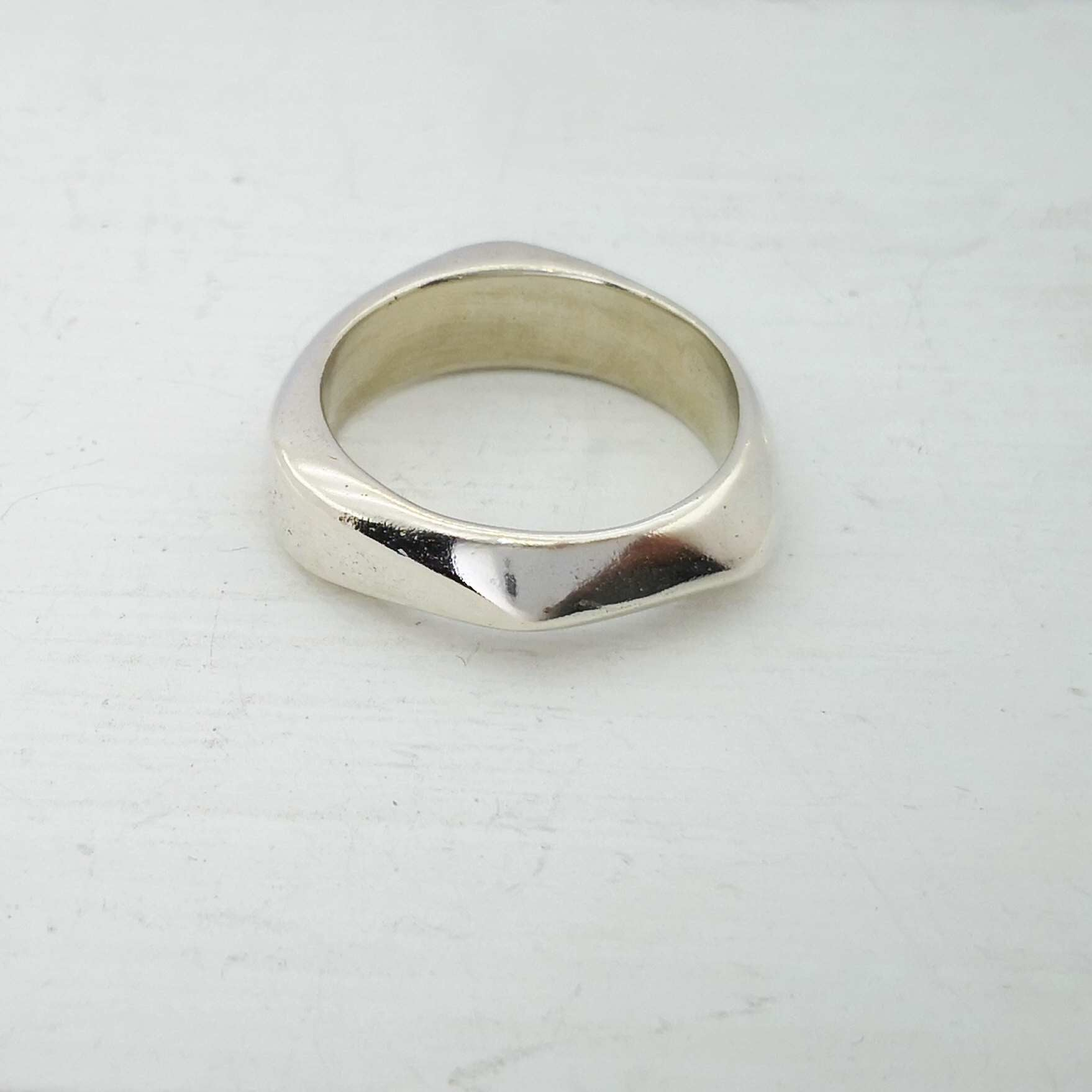 Angled ring in solid silver by Emily Efford.