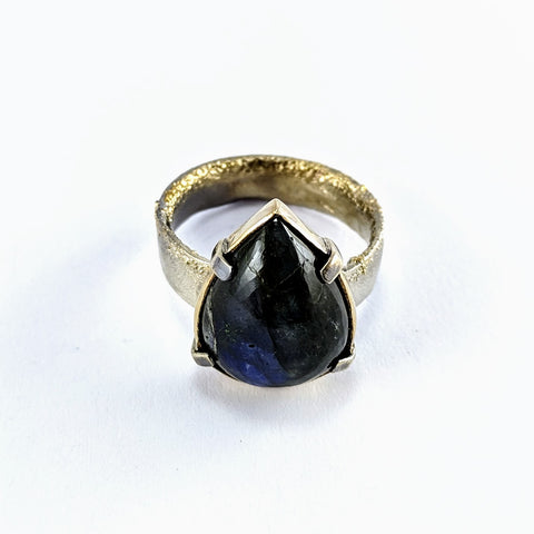 Labradorite Cabochon ring set in 9ct gold on a oxidised silver ring by Natalie Salisbury.