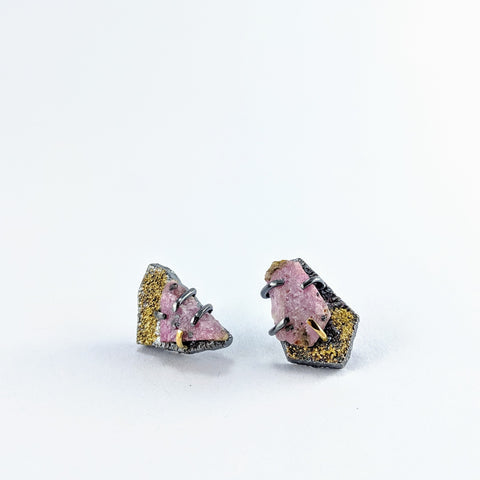 Organic raw ruby studs claw set on oxidised silver with fused 18 and 22ct gold dust.