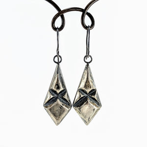Handmade in New Zealand by Fran Carter these ballroom drop earrings are solid silver with an antiqued patina.  Kite shaped with a criss cross engraving.