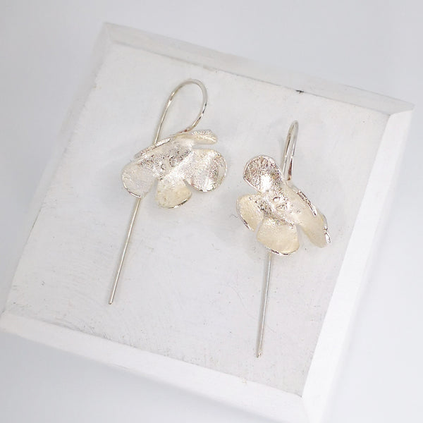 Wild flower earrings in bright silver by Herbert and Wilks.