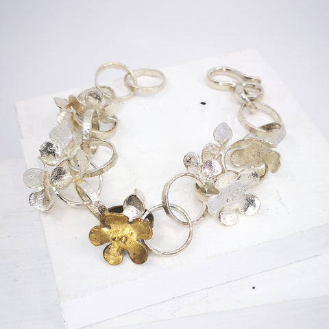 Wild flower bracelet in bright silver and bronze by Herbert and Wilks.