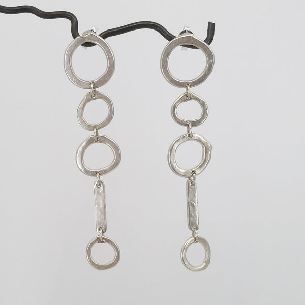 Silver abstract circle earrings by Herbert and Wilks