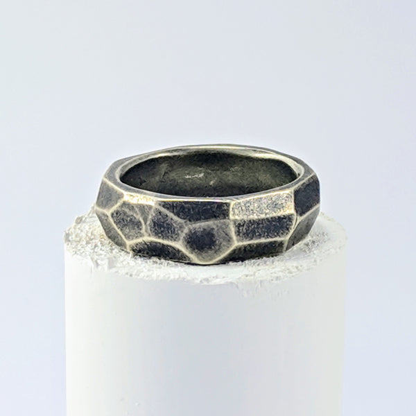 Handmade in New Zealand, this is a chunky oxidised silver ring with facets hand carved in wax and cast. by Buster Collins