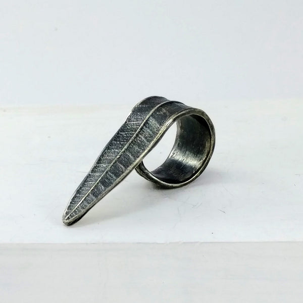 Handmade in New Zealand by Fran Carter. This leaf ring in oxidised silver wraps around your finger and across the top of your hand.