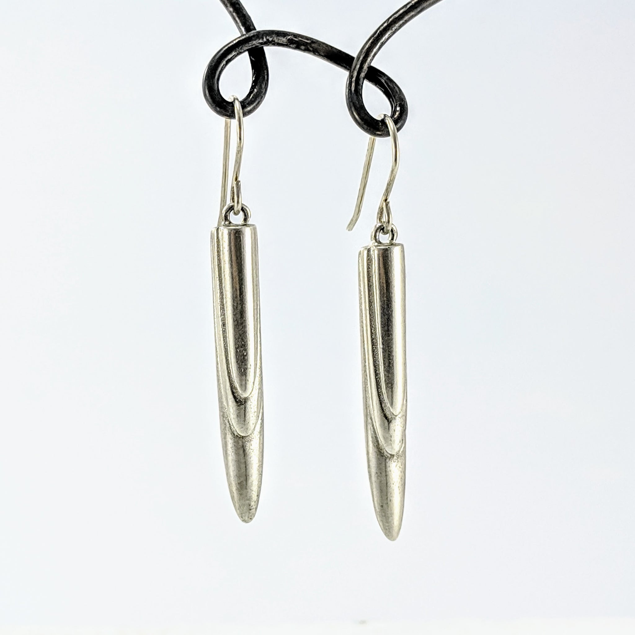 Handmade in New Zealand, these handmade deco earrings by Emily Efford Jewellery are silver with soft rounded scallops