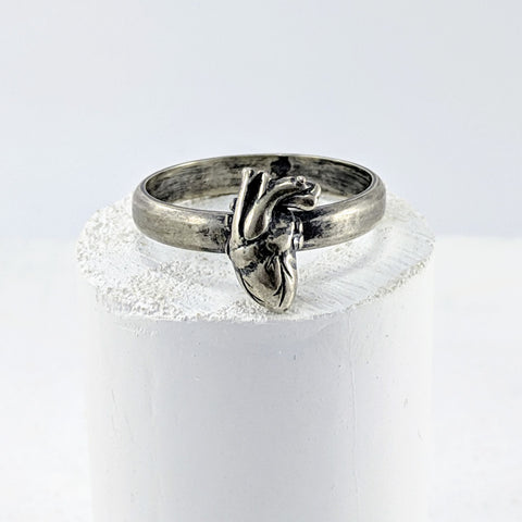 Handmade in New Zealand, this is a silver ring with a hand carved and cast anatomical heart set on the ring