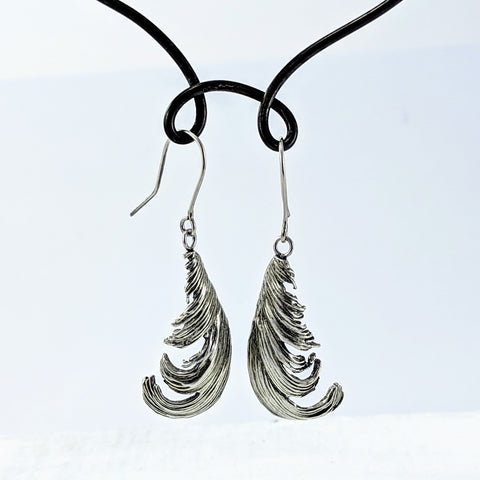 Unique jewellery handmade in New Zealand by Buster Collins.  Long silver feather earrings.