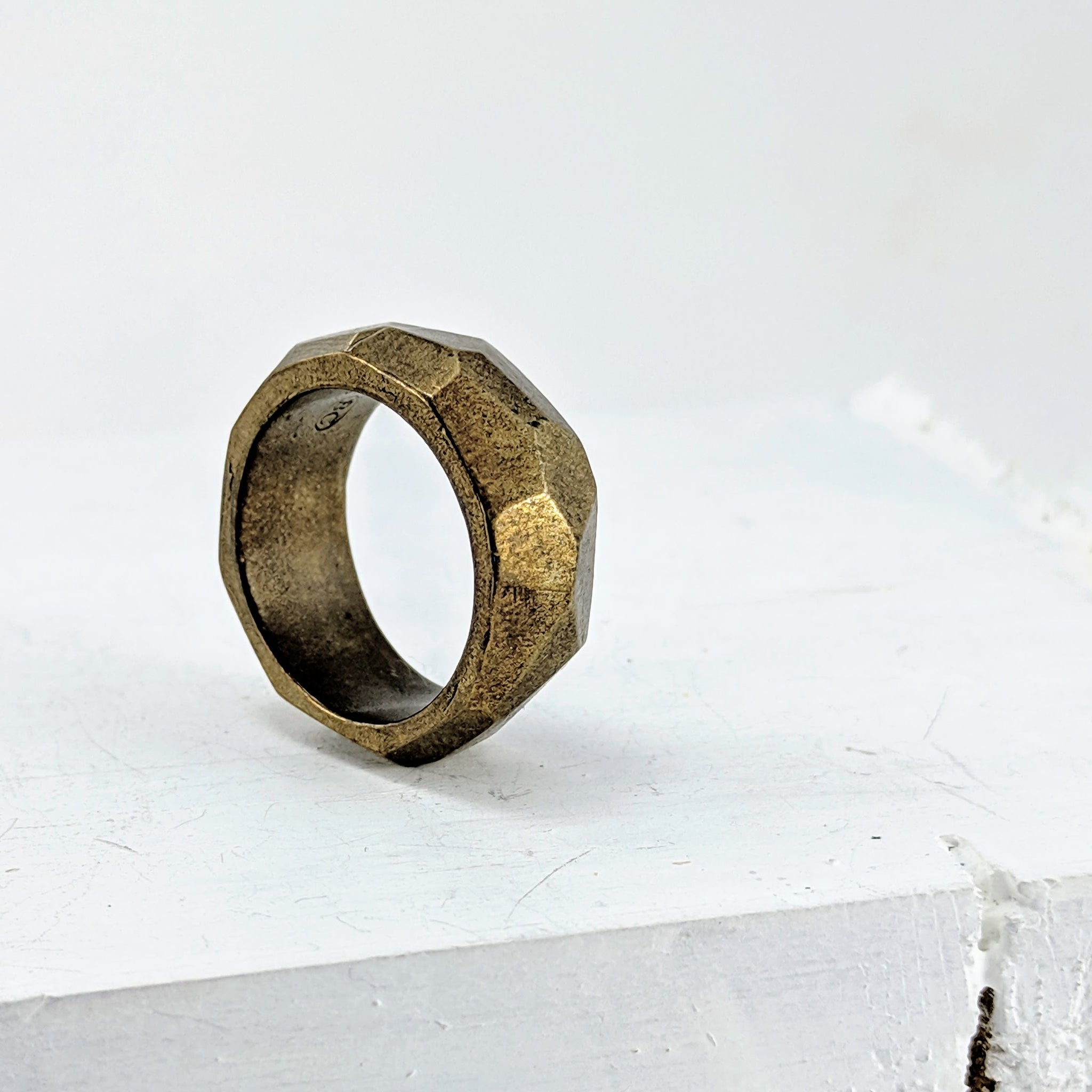 Handmade in New Zealand, this is a chunky bronze ring with facets hand carved in wax and cast. by Buster Collins