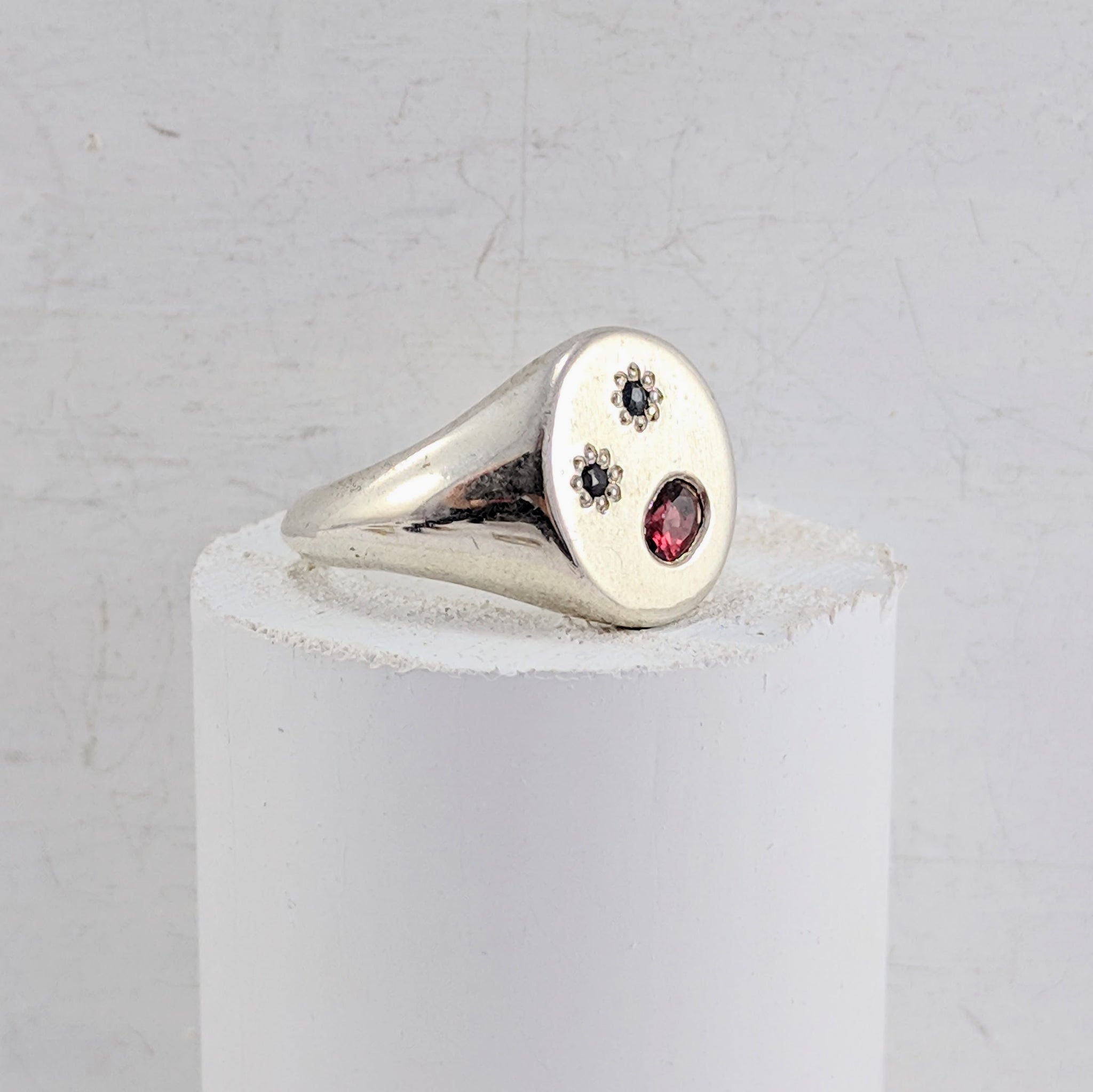 Stone set signet ring by Zoë Porter Jewellery.  Sterling silver oval shaped signet ring set with stones.