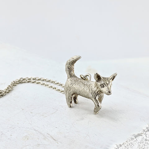 Silver Dog pendant by Vaune Mason.