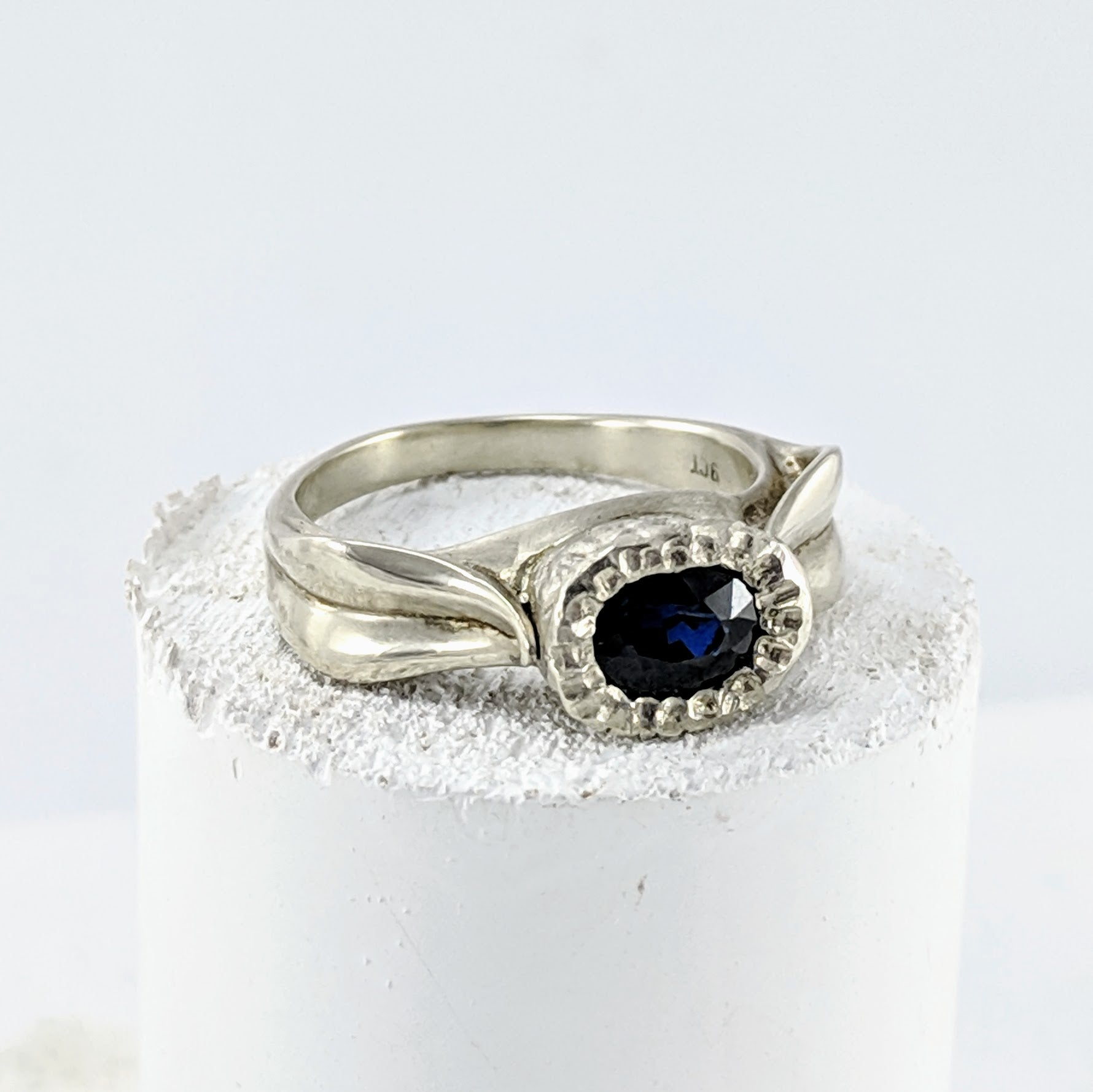 White gold leaf ring set with blue sapphire. Handmade in New Zealand by Vaune Mason.