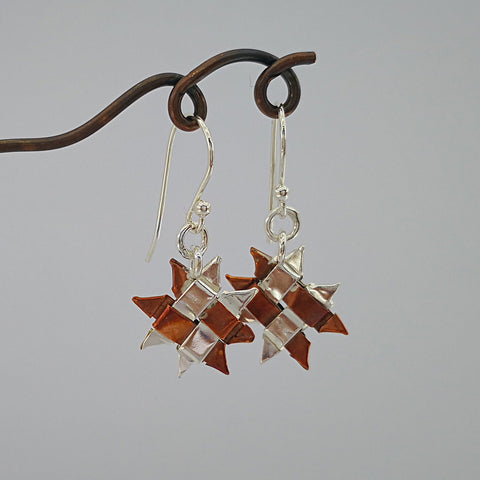 hand woven whetū (star) earrings in silver and copper by Keri-Mei Zagrobelna